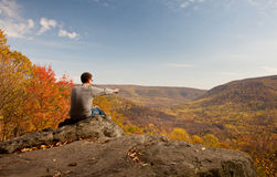 Young hiker relaxing on rock royalty free stock photo
