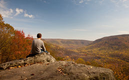 Young hiker relaxing on rock Royalty Free Stock Photography