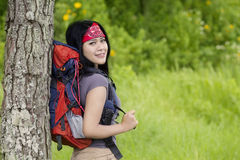 Young hiker relaxing on the tree Stock Image