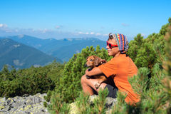 Young hiker with a small dog Stock Photo