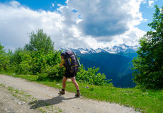Young hiker trekking in Svaneti Stock Photo