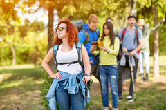 Young hiker woman with group of hikers in woods Stock Photos