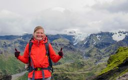 Young hiker woman show sight thumbs up and good luck Travel Lifestyle success concept stock photography