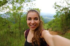 Young hiker woman take self portrait in brazilian forest.  royalty free stock photography