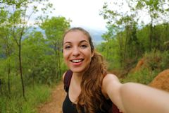 Young hiker woman take self portrait in brazilian forest.  royalty free stock image