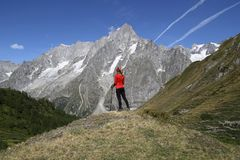 Young hiker woman in Val Ferret royalty free stock image