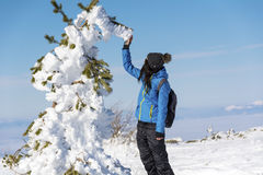 Young hiker woman in the winter mountain Stock Image
