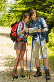 Young hikers couple checking the map Royalty Free Stock Image