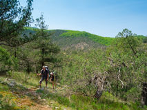 Young hikers couple walking Royalty Free Stock Image