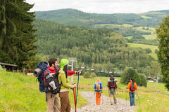 Free Young Hikers Enjoying Scenic View On Mountain Royalty Free Stock Photo - 29932925
