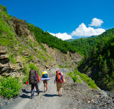 Young hikers trekking in Svaneti, Royalty Free Stock Photos
