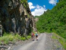 Young hikers trekking in Svaneti,. Georgia Royalty Free Stock Photo
