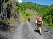 Young hikers trekking in Svaneti,. Georgia Royalty Free Stock Images