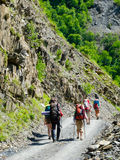 Young hikers trekking in Svaneti,. Georgia Royalty Free Stock Image