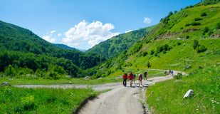 Young hikers trekking in Svaneti,. Georgia Stock Images