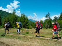 Young hikers trekking in Svaneti. Georgia Stock Photo