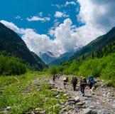 Young hikers trekking in Svaneti. Georgia Stock Photos