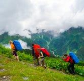 Young hikers trekking in Svaneti. Georgia Stock Images