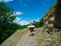 Young hikers trekking in Svaneti. Georgia Royalty Free Stock Photos
