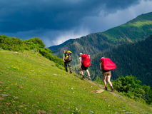 Young hikers trekking in Svaneti, Royalty Free Stock Images