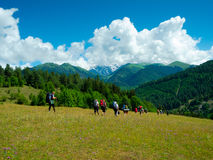 Young hikers trekking in Svaneti. Georgia. Ushba mountain in the background Stock Photos