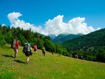 Young hikers trekking in Svaneti. Georgia. Ushba mountain in the background Royalty Free Stock Photos