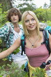 Young hiking couple in forest Royalty Free Stock Photography