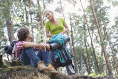 Young hiking couple looking at each other in forest Royalty Free Stock Photo