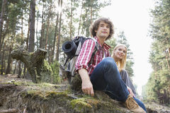 Young hiking couple relaxing in forest Stock Images
