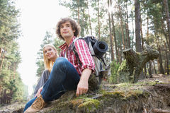 Young hiking couple relaxing in forest Royalty Free Stock Photography
