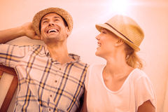 Young hip couple laughing on bench Royalty Free Stock Photos