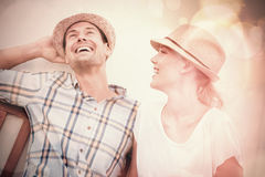 Young hip couple laughing on bench Royalty Free Stock Image
