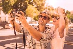 Young hip couple taking a selfie Stock Photos