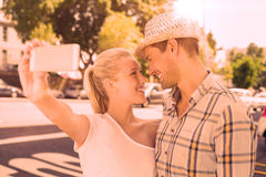 Young hip couple taking a selfie Stock Photography