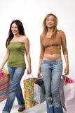 Young, hip female shoppers. Young and hip women with colorful shopping bags Stock Image