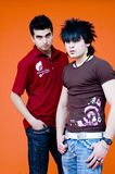 Young Hip Guys. Two hip guys wearing Dreamstime t-shirts Stock Images