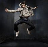 Young hip-hop. Dancer over a grunge wall Royalty Free Stock Photos