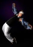 Young hip-hop dancer performing acrobatics. Royalty Free Stock Photos