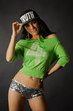 Hip-hop dancer. Young hip-hop dancer is posing in studio stock photo
