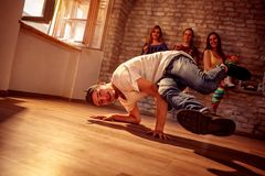 Young hip hop men performs break dancing moves royalty free stock photo