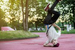 Young hip hop street dancer in the city during the dusk doing freeze stock photo