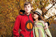 Young fashion hippie couple in love in autumn park Stock Photos