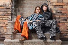 Young hippie couple sitting on the steps. Young fashionable hippie couple sitting on the steps Royalty Free Stock Photos