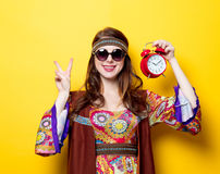 Young hippie girl with sunglasses and alarm clock Royalty Free Stock Images