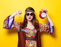 Young hippie girl with sunglasses and alarm clock Stock Images