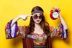 Young hippie girl with sunglasses and alarm clock Stock Photography