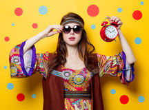 Young hippie girl with sunglasses and alarm clock Royalty Free Stock Photo