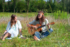 Young hippie men play on the guitar Royalty Free Stock Image