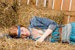 Young hippie woman lying on hay relax Stock Images