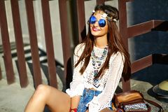 Young hippie woman model in summer sunny day in bright colorful hipster clothes. Funny stylish sexy smiling beautiful young hippie woman model in summer white Royalty Free Stock Image